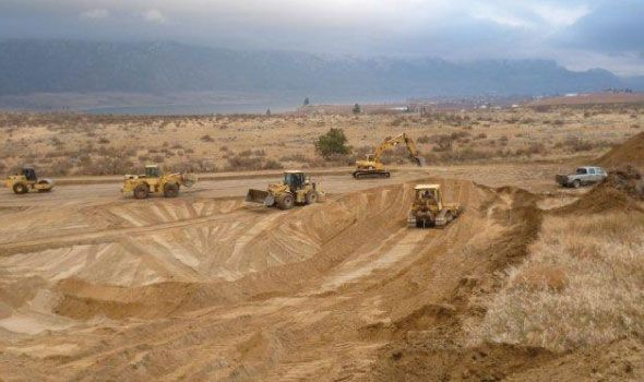 Heavy Equipment Performing Earthwork At Local Landfill